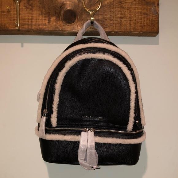0fc6b92b78a3 Michael Kors Rhea Zip Backpack with Shearling Trim